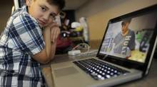 Ten year old Jordan Hilkowitz is photographed in the kitchen with a laptop showing his website on science experiments on June 8 2012. Since starting up a YouTube channel, Doctor Mad Science, showing his various experiments, Jordan, who has autism, has changed and is learning new skills and improved his speech. (Fred Lum/The Globe and Mail)