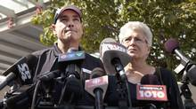 George Smitherman, accompanied by close friend Barbara Hall, makes a statement to reporters outside Toronto Western Hospital Sept. 11, 2013. (Moe Doiron/The Globe and Mail)