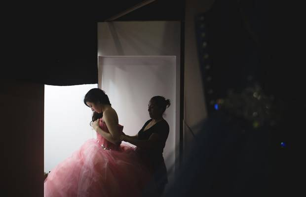 Yanahi Demetrio, a 14-year-old girl from Mexico City, tries on a dress by Amaraby at 15Fest. Yanahi had not yet decided on her dress.