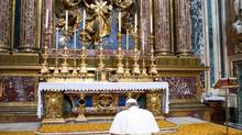 In this photo provided by the Vatican newspaper L'Osservatore Romano, Pope Francis kneels in prayer in front of the icon of the Virgin Mary inside St. Mary Major Basilica, in Rome, Thursday, March 14, 2013. (L'Osservatore Romano/AP)
