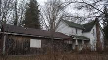 """This abandoned farmhouse in Pickering, pictured in 2011, was believed to house a """"confinement room"""" in the basement, according to Durham police. The house was destroyed in a fire in January 2012. (The Globe and Mail/Kevin Van Paassen/The Globe and Mail/Kevin Van Paassen)"""