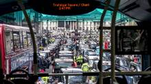 A bus is halted in central London traffic, snarled by hundreds of taxi drivers protesting the smartphone-based cab service Uber on Wednesday. (ANDREW TESTA/NYT)