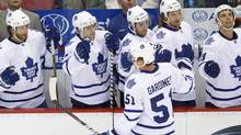 Toronto Maple Leafs defenseman Jake Gardiner (51) receives congratulations from teammates after scoring a goal in the first period of an NHL preseason hockey game on Friday, Sept. 30, 2011, in Detroit. (AP Photo/Rick Osentoski) (Rick Osentoski/Rick Osentoski)