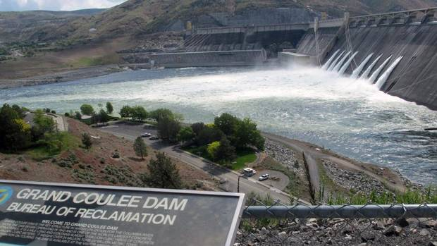 Water is released through the outlet tubes at Grand Coulee Dam, Wash.