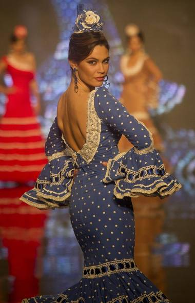 A model wears a creation by designer Carmen Vega at the Flamenco Fashion Show in Seville, Spain. (Miguel Angel Morenatti/AP)