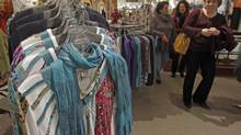 Canadians plan to spend less in 2014 than they did last year. (Toby Talbot/The Associated Press)