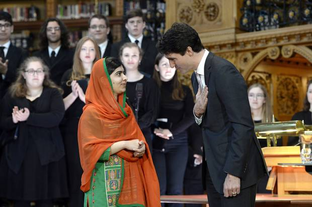 Pakistani activist and Nobel Peace Prize winner Malala Yousafzai, left, is presented with an honorary Canadian citizenship by Prime Minister Justin Trudeau in on Parliament Hill in Ottawa on April 12, 2017.