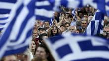 Conservative New Democracy ruling party supporters wave national flags and shout slogans during a pre-election campaign speech of Greece's Prime Minister Antonis Samaras (not pictured) in Athens, May 23, 2014. Greeks vote both in local and European Parliament elections on Sunday. (ALKIS KONSTANTINIDIS/REUTERS)