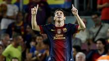 Barcelona's Lionel Messi celebrates his second goal against Real Sociedad during their Spanish first division soccer match at Camp Nou stadium in Barcelona August 19, 2012. (GUSTAU NACARINO/REUTERS)