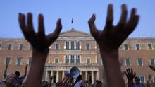 Protesters rally against austerity economic measures and corruption in Athens' Syntagma square. (PASCAL ROSSIGNOL/REUTERS)