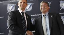 Tampa Bay Lightning owner Jeff Vinik shakes hands with former Detroit Red Wings vice-president Steve Yzerman after announcing Yzerman as the Lightning's new general manager during a news conference in Tampa. (BRIAN BLANCO)