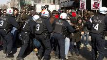 Students protesting rising tuition costs clash with police in Montreal on March 7, 2012. (Marie-Esperance Cerda/THE CANADIAN PRESS/Marie-Esperance Cerda/THE CANADIAN PRESS)