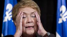 Quebec elected premier Pauline Marois reacts as she comments on the tragic events of the previous evening during a news conference following her victory Sept. 5, 2012 in Montreal. (Paul Chiasson/THE CANADIAN PRESS)