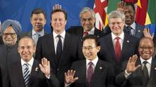 Canadian Prime Minister Stephen Harper waves with other G20 leaders as they pose for the family photo at the G-20 Summit in Los Cabos, Mexico, on June 18, 2012. (Adrian Wyld/The Canadian Press)