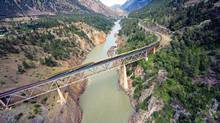 The Rocky Mountaineer passes over the Canyon Bridge near Lillooet, B.C. (Rock Mountaineer)