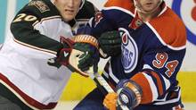 Minnesota Wild's Ryan Suter, left, defends against the Edmonton Oilers' Ryan Smyth during third period NHL action in Edmonton, Alta., on Tuesday, April 16, 2013. (John Ulan/THE CANADIAN PRESS)