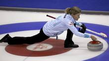 Skip Sherry Middaugh of Team Middaugh throws a rock against Team Homan during draw seven at the Roar of the Rings Canadian Olympic Curling Trials in Winnipeg, Manitoba December 3, 2013. Middaugh advanced to the semi-final on Friday downing Chelsea Carey 6-3 in the tiebreaker. (REUTERS)