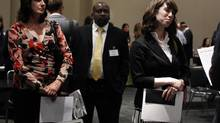Job seekers wait to speak to a recruiter during the Gemological Institute Of America (GIA)'s Jewelry Career Fair in New York. (SHANNON STAPLETON/REUTERS)