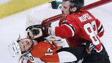 Chicago Blackhawks' Tomas Kopecky hits Philadelphia Flyers' Daniel Carcillo during the second period of Game 2 of their NHL Stanley Cup final in Chicago May 31, 2010. (JEFF HAYNES/REUTERS)
