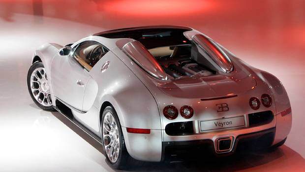 Bugatti Veyron 16.4 Grand Sport. Estimated 2013 base price - $2.25 million U.S. (FRANCOIS MORI/AP Photo)