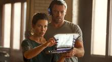 "Hugh Jackman and Evangeline Lilly in a scene from ""Real Steel"" (Melissa Moseley/Dreamworks)"