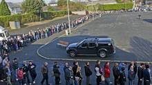 Job seekers line up to get into the Working Abroad Expo in Dublin. (Laura Hutton/Photocall Ireland)