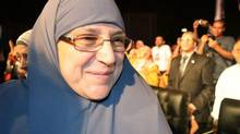 Naglaa Ali Mahmoud attends a rally during a campaign rally for her husband, then presidential candidate Mohammed Morsi, in Cairo May 12. She is now Egypt's first lady, though she prefers the term 'first servant.'