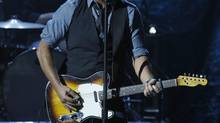 Musician Bruce Springsteen performs during Hurricane Sandy: Coming Together, a Red Cross telethon on NBC to benefit victims of Hurricane Sandy, the storm that killed more than 100 and devastated parts of the U.S. Northeast, in New York, Nov. 2, 2012. (REUTERS)
