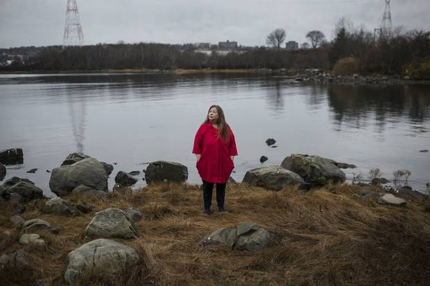 Cathy Martin of Millbrook First Nation stands on the shores opposite Halifax where Mi'kmaw families once lived at Kepe'kek, which means 'at the narrows,' until disaster struck in the Halifax Explosion 100 years ago.