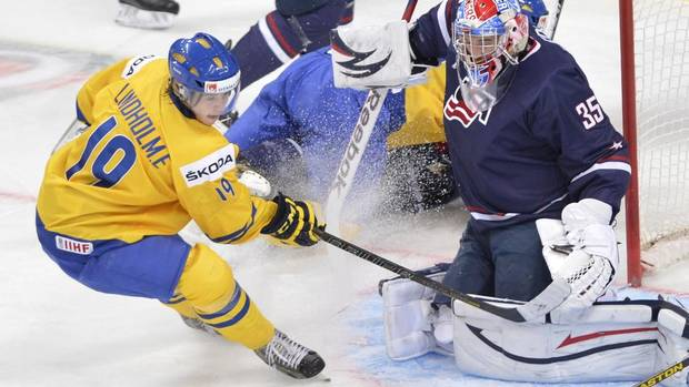 Team USA goaltender John Gibson makes a save off Sweden's Elias Lindholm during first period gold medal hockey action at the IIHF World Junior Championships in Ufa, Russia, on Saturday, Jan. 5, 2013. (Nathan Denette/THE CANADIAN PRESS)