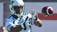 Saskatchewan Roughriders' Geroy Simon makes a catch during the warm-up prior to a CFL game against the Montreal Alouettes in Montreal, Sunday, September 29, 2013. (Graham Hughes/THE CANADIAN PRESS)