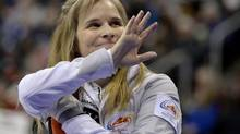 Skip Jennifer Jones waves to the crowd between ends against Team Middaugh during the women's final at the Roar of the Rings Canadian Olympic Curling Trials in Winnipeg December 7, 2013. (FRED GREENSLADE/REUTERS)