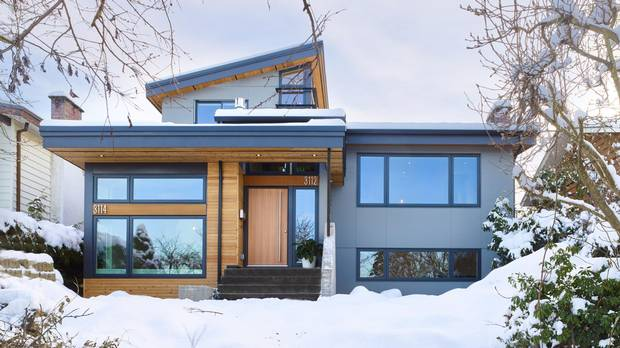 Maya and Derrick Yue, and Maya's parents, Eriko and Aki Taguchi, converted this 1966 split-level Vancouver Special house into what looks and feels like a side-by-side duplex.
