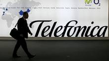 A visitor walks in front of Spanish communications company Telefonica's stand at the 3GSM World Congress in Barcelona on Feb. 15, 2007. (ALBERT GEA/REUTERS)
