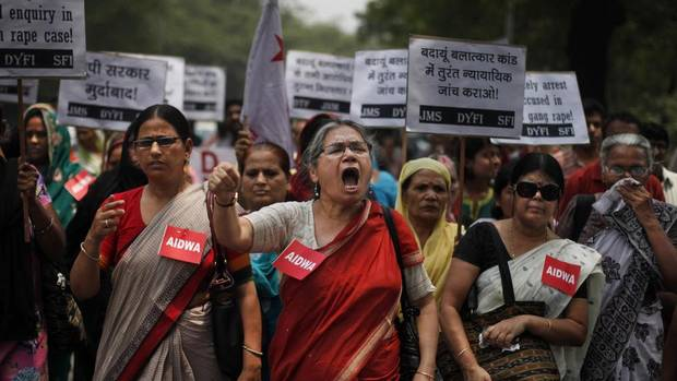 Members of the All India Democratic Women's Association shout slogans during a protest in New Delhi against the gang rape of two teenage girls. (ALTAF QADRI/ASSOCIATED PRESS)