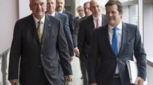 Bombardier president and CEO Pierre Beaudoin, right, and his father Laurent, chairman of the board, arrive at the company's annual meeting Thursday, May 1, 2014 in Montreal. (Paul Chiasson/THE CANADIAN PRESS)