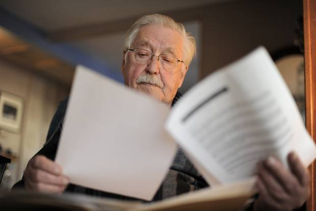 Ken Fritz, an 82-year-old retired small business owner from Regina, looks over documents from a stock scam he got ripped off in more than a decade ago.
