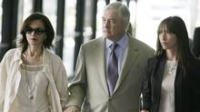 Conrad Black leaves the federal building in Chicago on July 13, 2007, with his wife Barbara Amiel Black and daughter Alana Black after jurors returned a mixed verdict in his fraud and racketeering trial. (M. Spencer Green/The Associated Press/M. Spencer Green/The Associated Press)