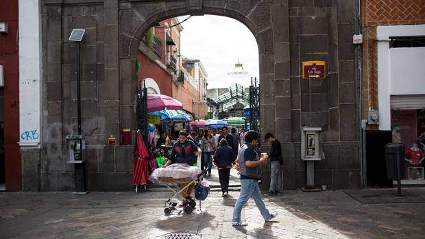 People and vendors in the main plaza of Puebla, Mexico.