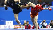 Wushu, a full-contact sport combining martial arts with grappling, could lure millions of viewers from Asia. (Jason Lee/REUTERS)