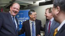 Thomas Kloet, CEO of TMX Group, Li Fanrong, CEO of CNOOC, Kevan Cowan, President, TSX Markets and Group Head of Equities and Yang Hua, Vice Chairman of the Board of Directors of CNOOC, speak with each other prior to the launch of CNOOC on the TSX at the Toronto Stock Exchange. The China National Offshore Oil Corporation is one of the major national oil companies of China. (Philip Cheung For The Globe and Mail)