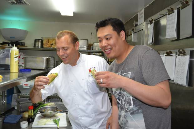 Chef Lawrence Hui and Chef Charlie Owen eating poke at the Hula Grill.
