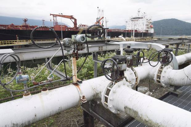 A ship receives its load of oil from the Kinder Morgan Trans Mountain Expansion Project's Westeridge loading dock in Burnaby, British Columbia, on June 4, 2015.