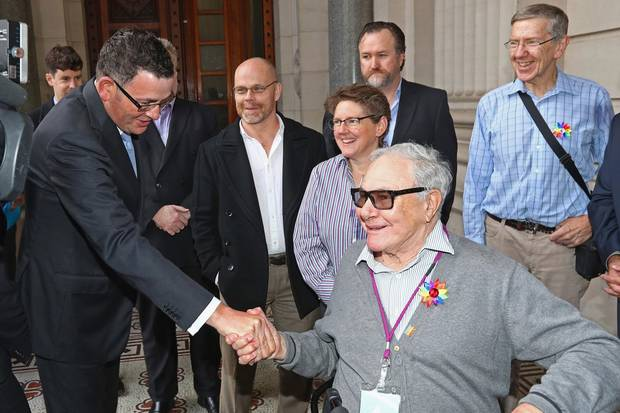 May 24, 2016: Daniel Andrews, Premier of the Australian state of Victoria, shakes hands with Noel Tovey before making an apology to the Victorian gay community at Parliament House in Melbourne.