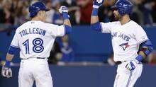 Toronto Blue Jays' Steve Tolleson congratulates teammate Jose Bautista (Frank Gunn/THE CANADIAN PRESS)