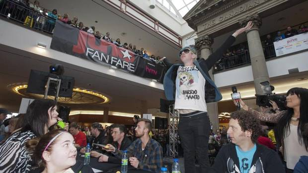 Josh Ramsay from the band Marianas Trench pumps up the crowd while he signs autographs at Juno Fan Fare prior the 2013 Juno Awards in Regina on Saturday, April 20, 2013. (Liam Richards/THE CANADIAN PRESS)