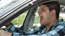 On the road, you either keep quiet or you act out. Communicating on the road tends to involves, well, being a jerk. Usually dangerously so. (ARENA Creative/Getty Images/iStockphoto)