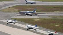 File photo of planes on the runway at John F. Kennedy International Airport in New York. (Mark Lennihan/AP Photo)