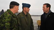 Colonel Russ Williams (centre), charged with two counts of first degree murder, walks with General Walter J. Natynczyk, Chief of the Defence Staff, and Defence Minister Peter MacKay on Jan. 17, 2010. (Warrant Officer Carole Morissett/Canadian Department of National Defence Photo)