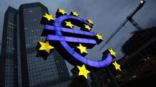 The illuminated euro sign is seen in front of the headquarters of the European Central Bank. (KAI PFAFFENBACH/REUTERS)